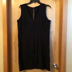 Black sleeveless, v neck. Polyester and rayon
